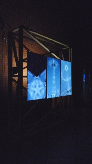 Leslie Thornton, Luna, 2013, 3-channel HD video, exhibited on 3 large-scale monitors mounted vertically on wooden structure, installation view, Moving Image, March 6-8, 2014. Courtesy Winkleman Gallery, New York. Photo by the author.