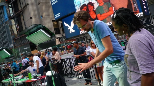 Artist Daniel Canogar during the filming of Storming Times Square, July 24, 2014. Photo © Kathleen MacQueen.